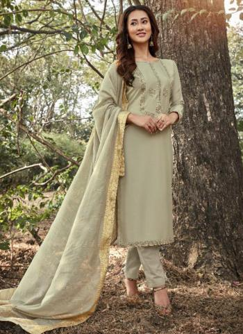 Beige Muslin Traditional Wear Embroidery Work Straight Suit