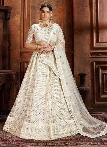 Thread Work Off White Net Wedding Wear Lehenga Choli