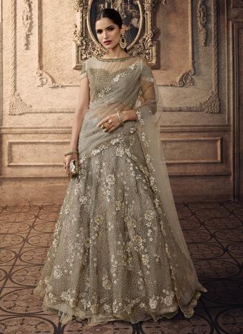 Beige Net Reception Wear Heavy Embroidery Work Lehenga Choli