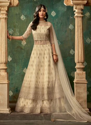 Beige Net Wedding Wear Thread Work Lehenga Suit