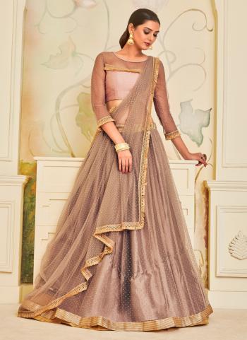 Beige Net Wedding Wear Lace Work Lehenga Choli