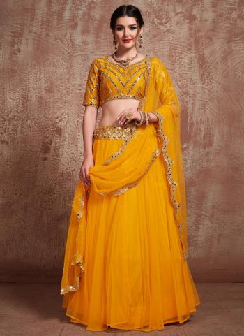 Mustard Net Wedding Wear Sequins Work Lehenga Choli