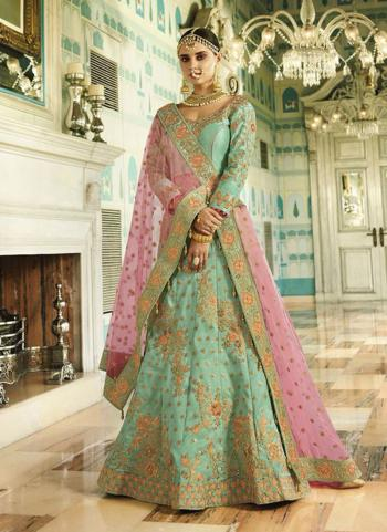 Pista Green Silk Bridal Wear Heavy Embroidery Work Lehenga Choli