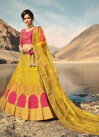 Embroidery Work Pink And Yellow Silk Bridal Wear Lehenga Choli