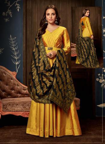 Yellow Tapeta Silk Wedding Wear Hand Work Gown