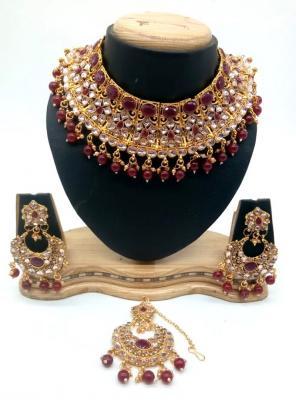 Maroon Bridal Kundan Necklace Set With Earrings And Maang Tikka