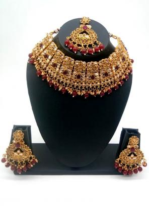 Maroon Beautiful Stone And Kundan Studded Bridal Necklace Set
