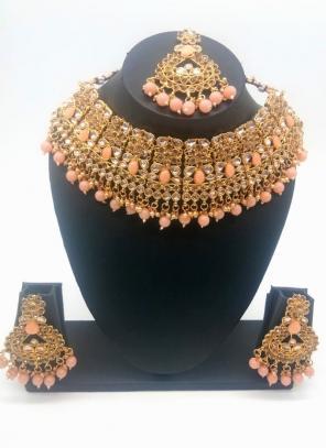Peach Beautiful Stone And Kundan Studded Bridal Necklace Set