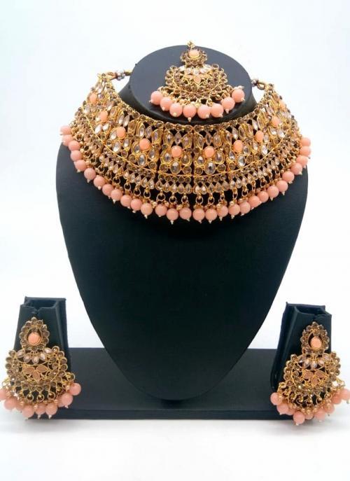 Peach Traditional Kundan And Stone Studded Chokar Necklace Set